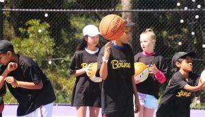 Coach Eban Hyams teaches basketball and life skills on the Abel Dunn Court in Warwick Farm.