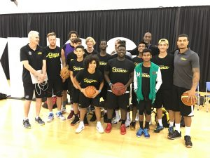 The Stand Tall All Stars taking it all in with the Sydney Kings Coach and Legend Andrew Gaze.