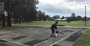 Charity Bounce Youth Support Worker Joshua getting the court ready for the first Stand Tall weekly program in Bidwill.