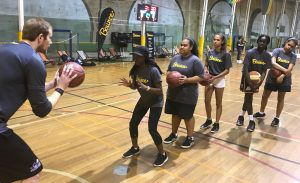 Sydney Kings player Tom Garlepp turned up to give some of his own basketball tips for the young women.