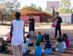 Kevin handing out some Illawarra Hawks gear after to wrap up the Stand Tall program.