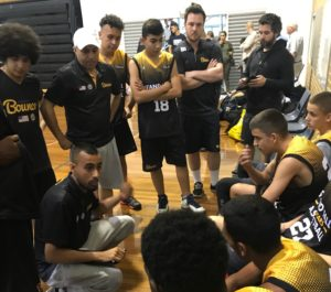 Head Coach Mahesh leading the team during the tournament.