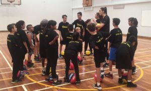 Laura Hodges inspiring the students on court at the Stand Tall program.