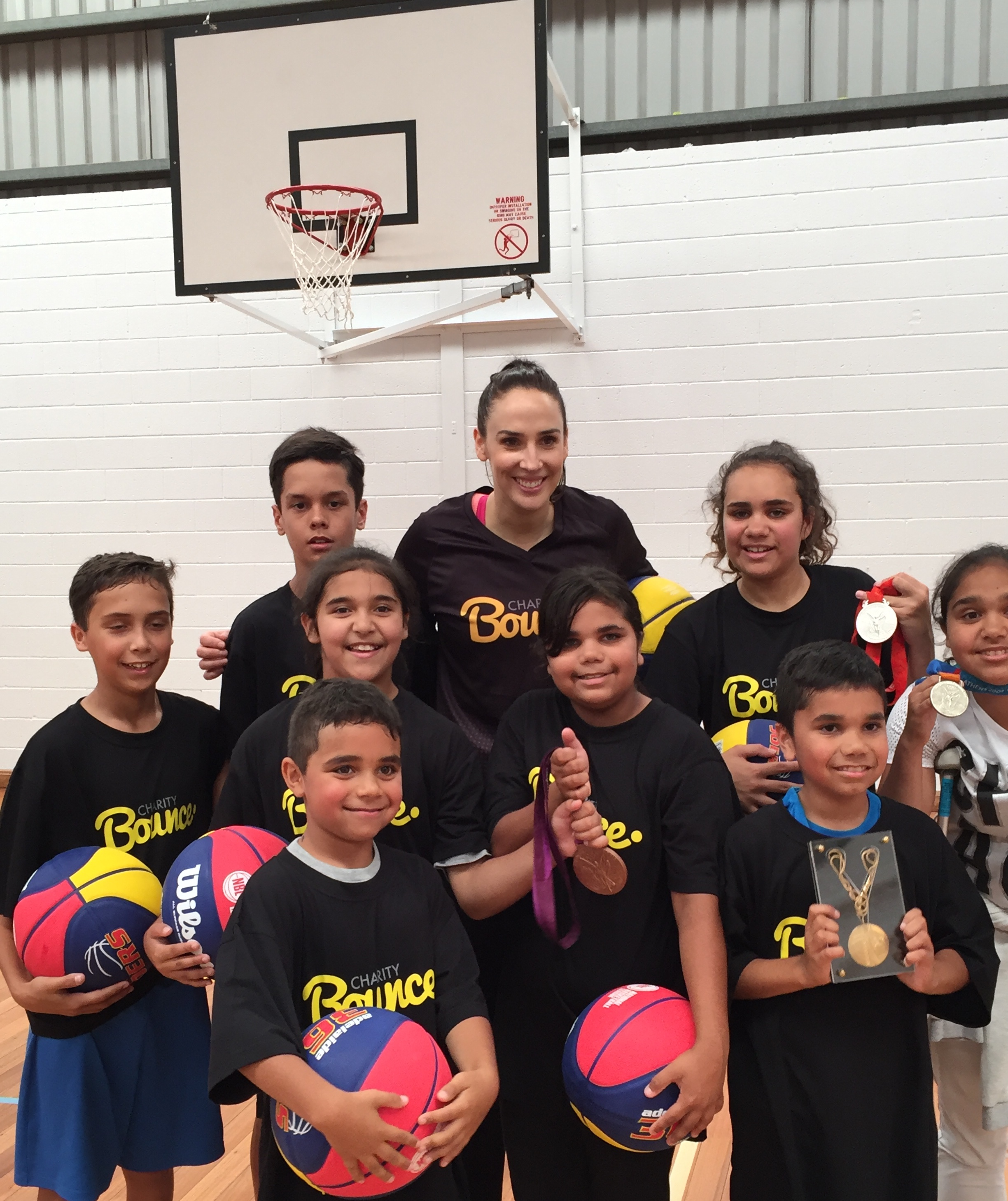 Laura Hodges shared about the Olympic values at the Stand Tall program to encourage the students.