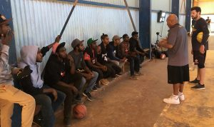 Charity Bounce Program Director and Basketball Legend, Cal Burton speaks with young men in Alice Springs