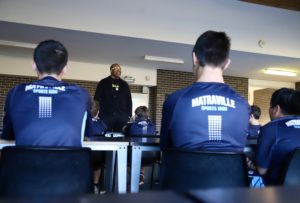 Former Harlem Globetrotter Tracy Williams speaking with the students at Matraville Sports High School.