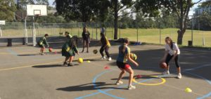 Working on the skills and drills at the Stand Tall program at South Strathfield.