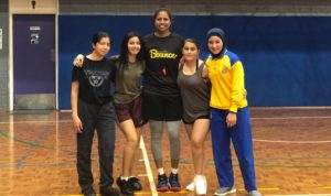 Coach Josie with some of the young women who are part of the Stand Tall project.